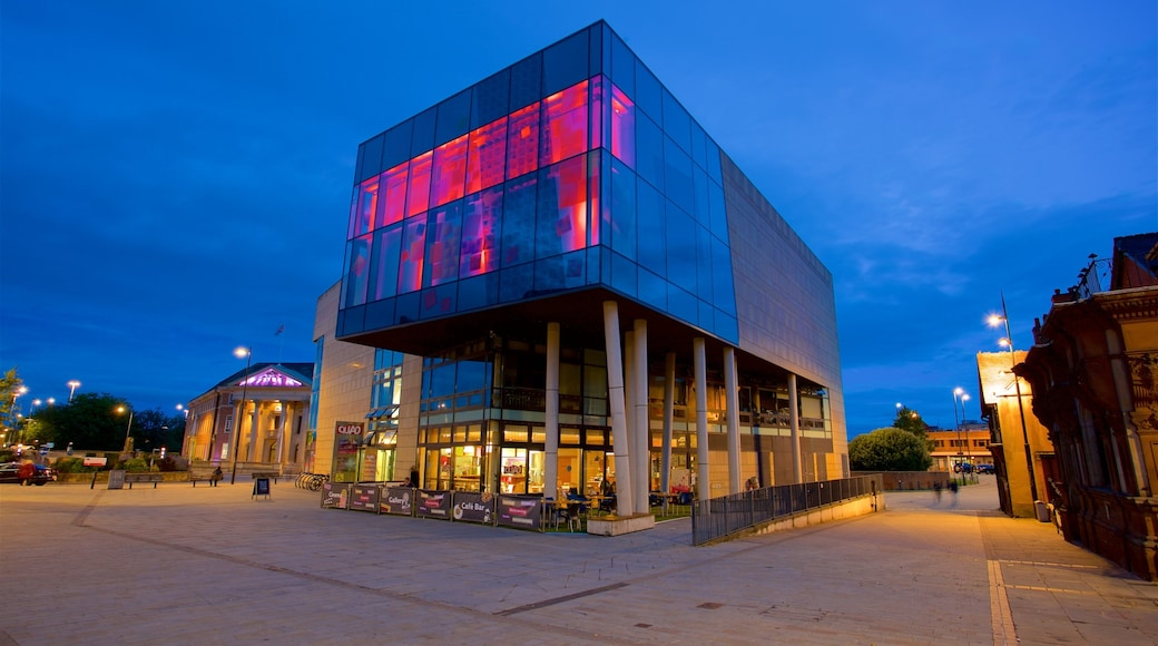 Quad featuring night scenes and modern architecture