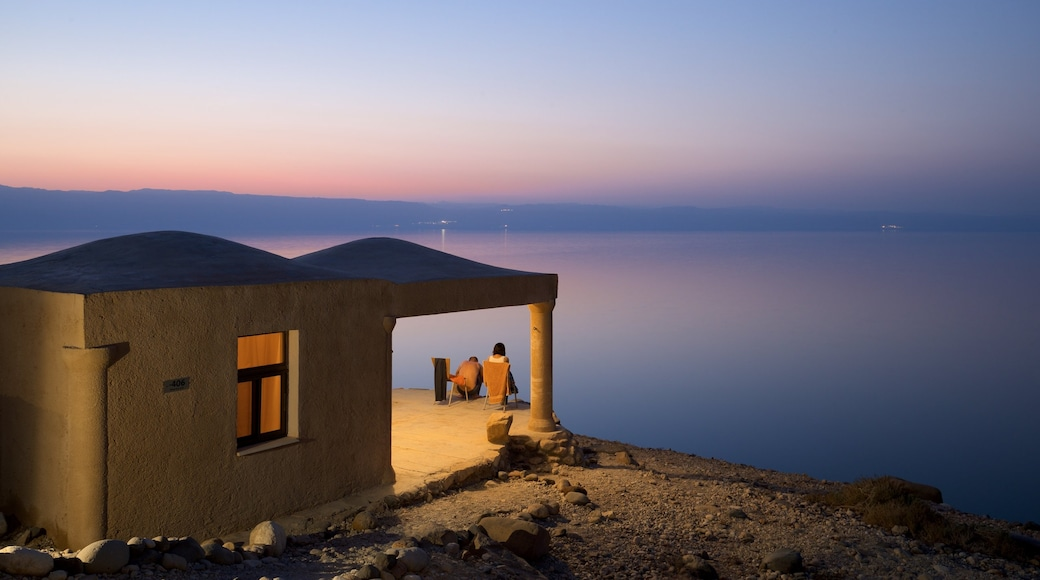Mujib Nature Reserve showing a sunset, general coastal views and a house
