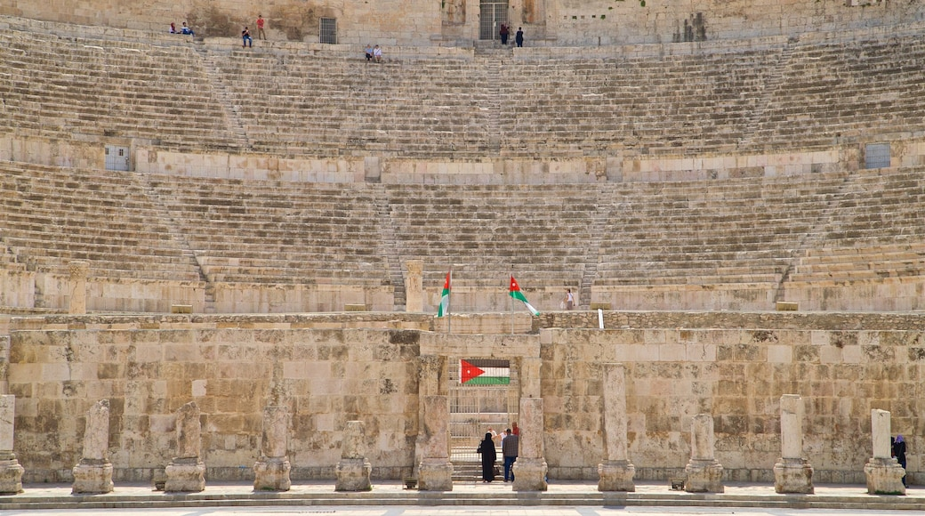 Amman Roman Theater showing heritage architecture and theatre scenes as well as a couple