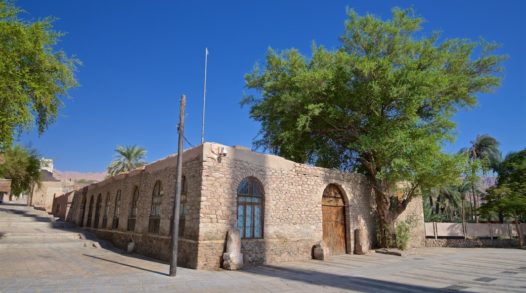 Aqaba Fort featuring heritage elements and a house