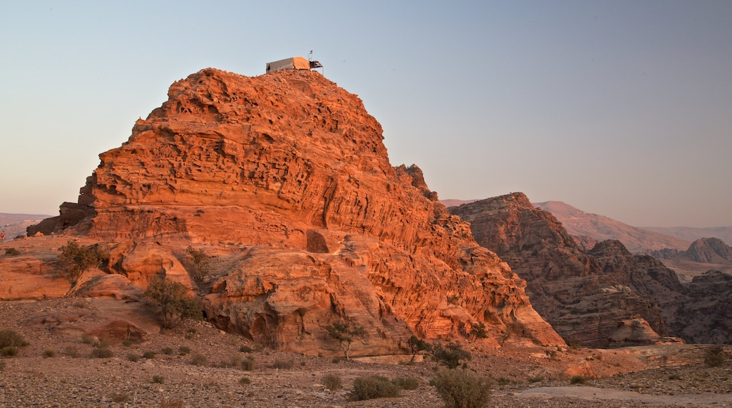 Petra which includes landscape views, a sunset and a gorge or canyon