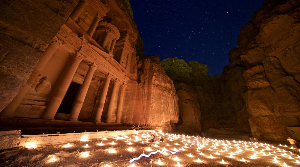 Wadi Musa which includes heritage architecture, a gorge or canyon and night scenes