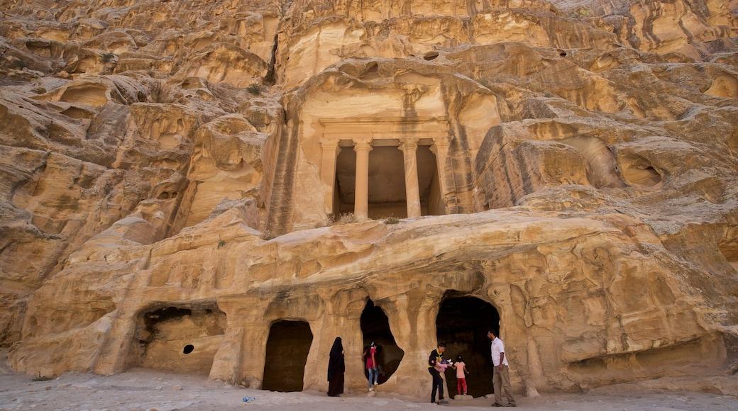 Little Petra showing heritage architecture and a gorge or canyon as well as a small group of people