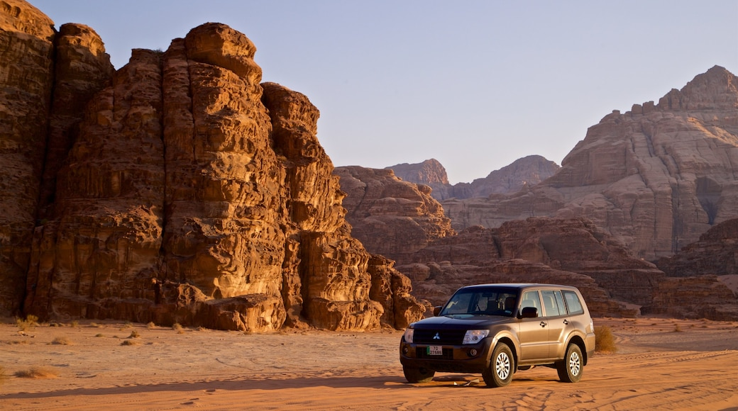 Wadi Rum which includes landscape views, off road driving and a gorge or canyon