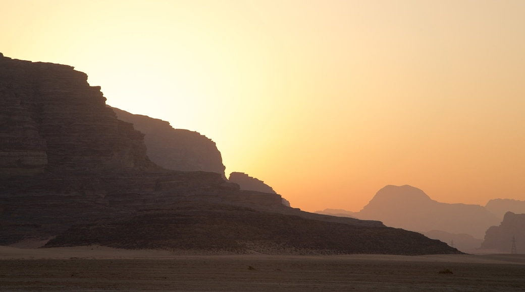 Wadi Rum showing a gorge or canyon, desert views and a sunset