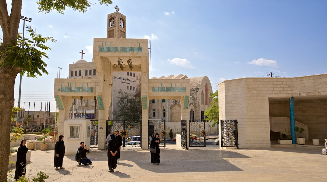 Coptic Orthodox Church which includes a church or cathedral as well as a small group of people