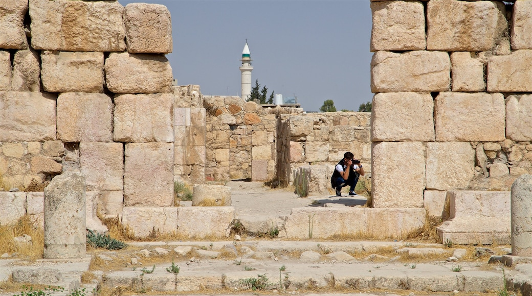Amman Citadel featuring heritage elements and a ruin as well as an individual male
