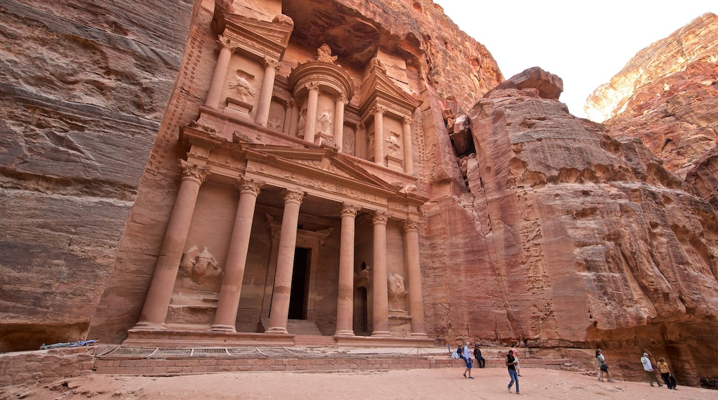 Wadi Musa featuring heritage architecture and a gorge or canyon as well as a small group of people