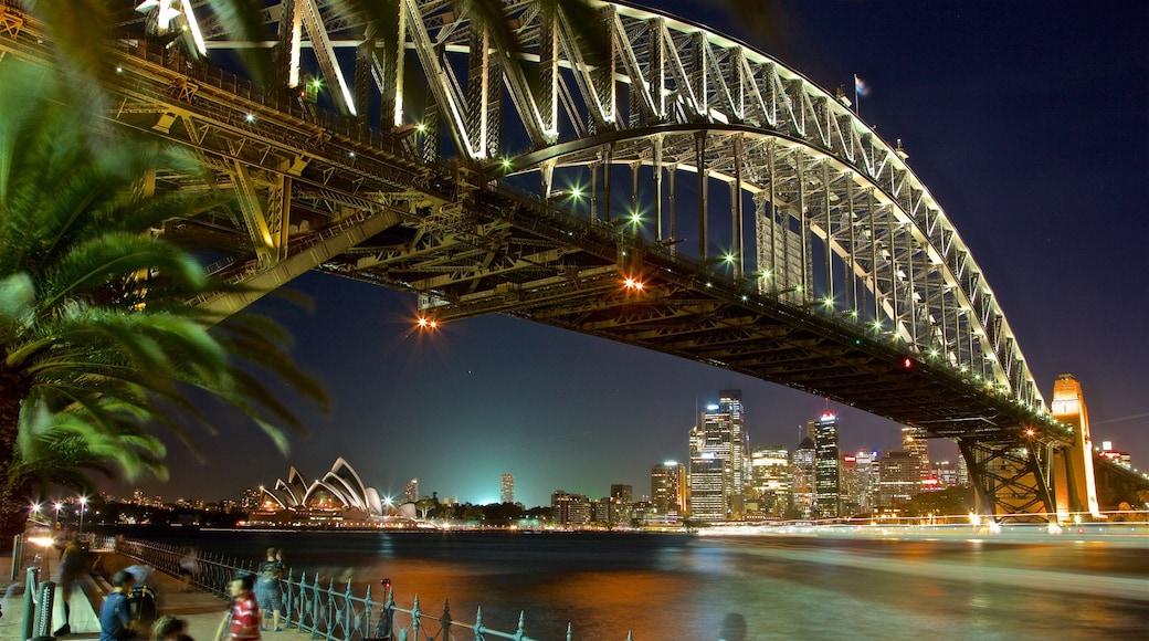 Sydney Harbour Bridge showing a city, night scenes and a bridge