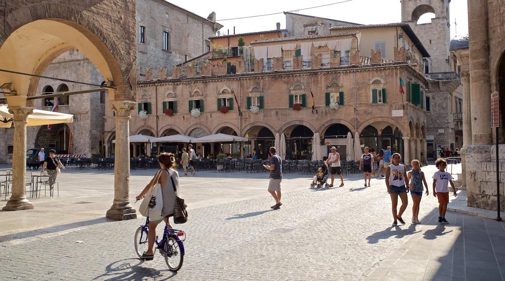 Piazza del Popolo welches beinhaltet Fahrradfahren und Straßenszenen sowie kleine Menschengruppe
