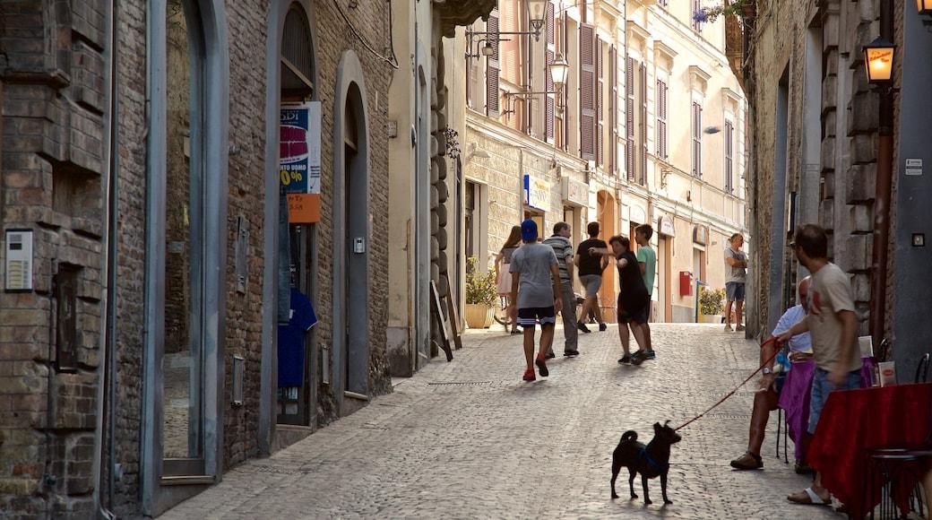Atri das einen Straßenszenen und niedliche oder freundliche Tiere sowie kleine Menschengruppe