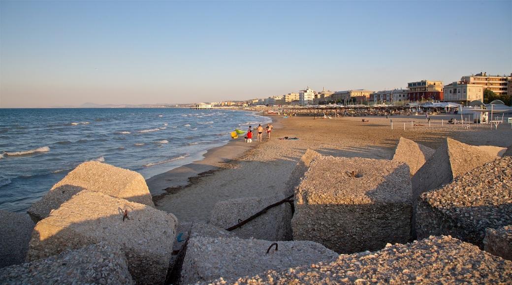 Senigallia mostrando tramonto, località costiera e spiaggia sabbiosa