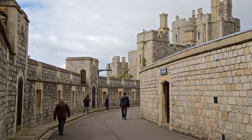 Windsor Castle featuring château or palace and heritage architecture as well as a small group of people
