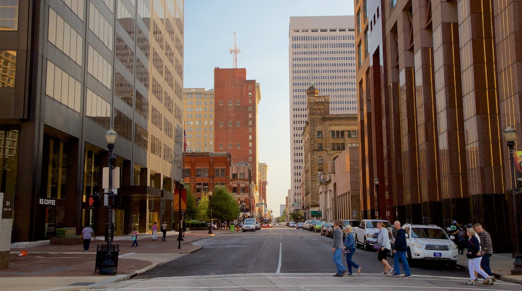 Louisville which includes street scenes and a city as well as a small group of people