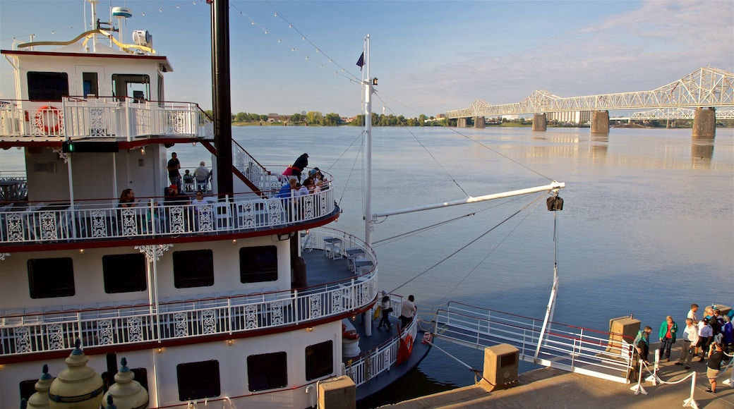 Belle of Louisville featuring a bay or harbor and a ferry as well as a small group of people