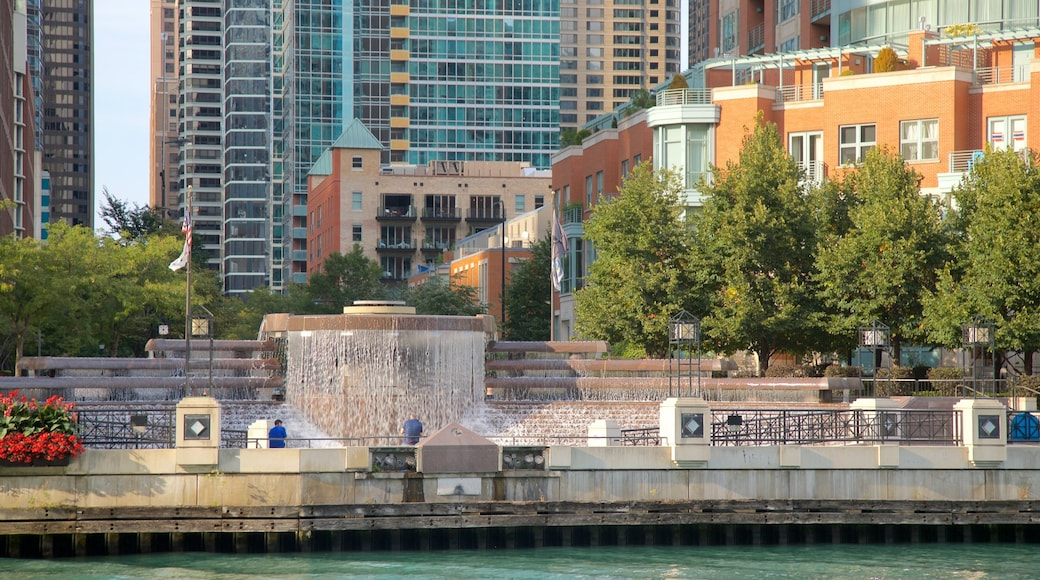 Chicago Riverwalk which includes a city and a river or creek