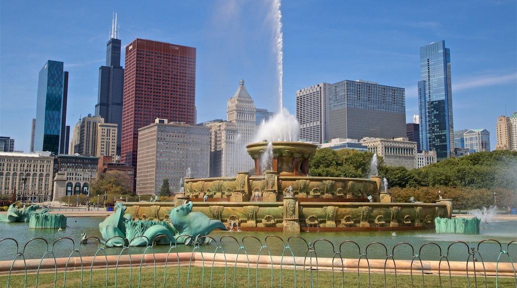 Buckingham Fountain ซึ่งรวมถึง อาคารสูง, น้ำพุ และ เมือง