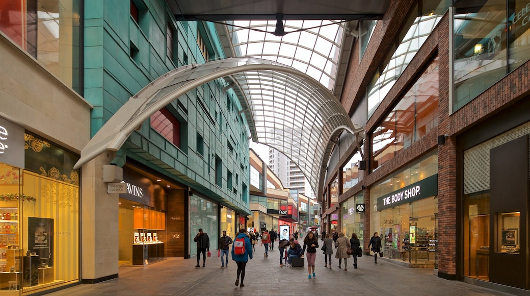 Cabot Circus Shopping Centre featuring shopping and street scenes as well as a small group of people