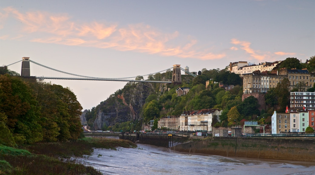 Bristol showing a sunset, a river or creek and a bridge