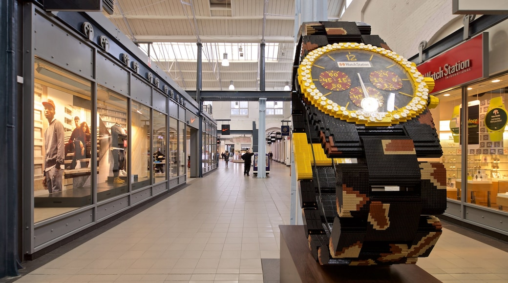 Swindon Designer Outlet featuring shopping, interior views and art