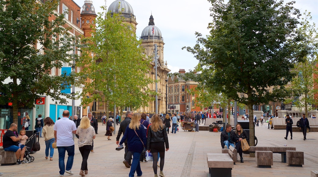 Hull which includes street scenes as well as a large group of people
