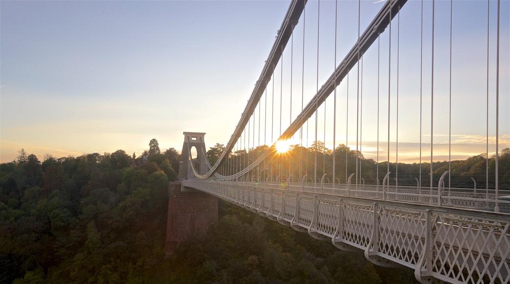 Clifton Suspension Bridge which includes a sunset, landscape views and a bridge