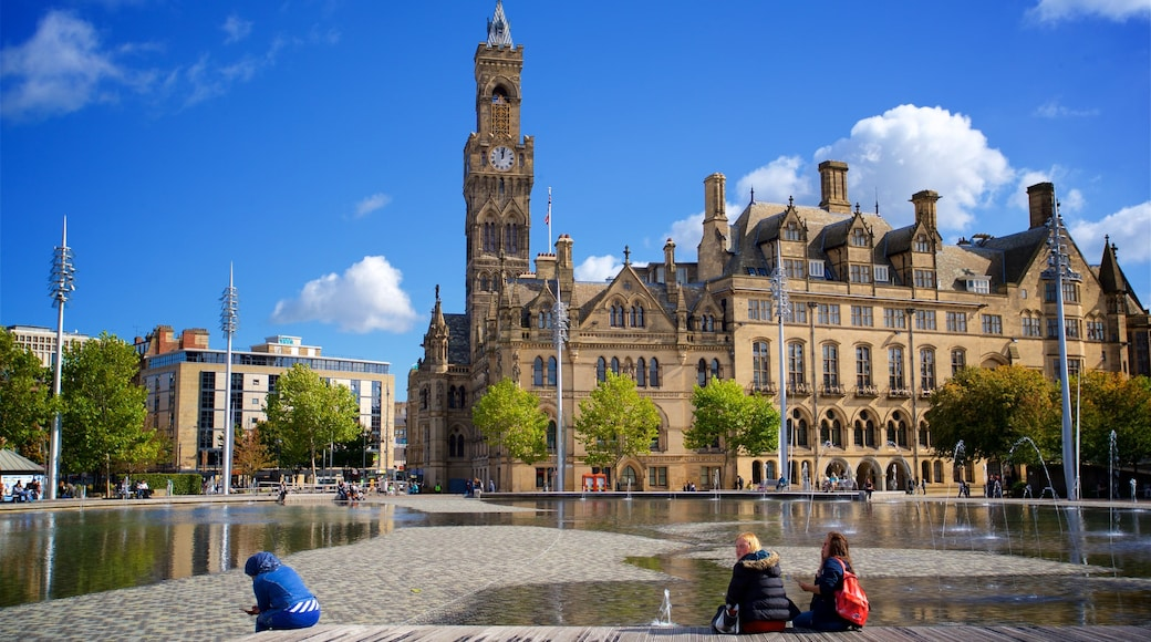 Bradford City Park showing a fountain and heritage architecture as well as a couple