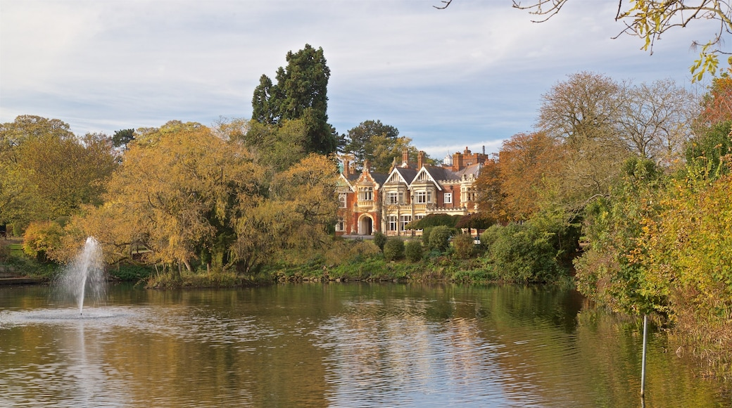 Bletchley Park featuring a house, a pond and a fountain