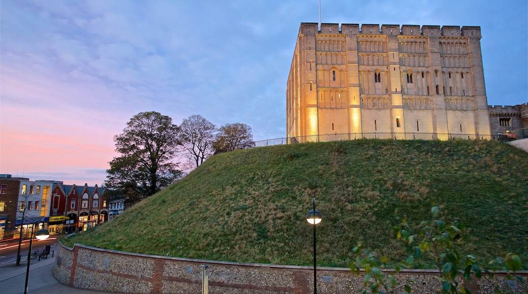 Norwich Castle featuring a sunset and heritage architecture