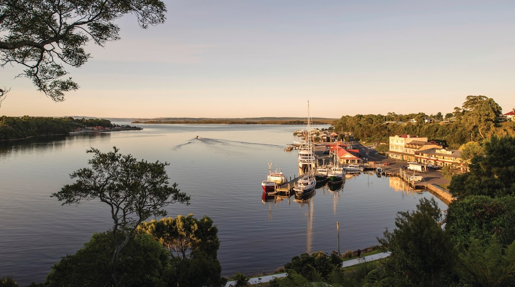 West Coast Tasmania which includes landscape views, a sunset and a bay or harbour