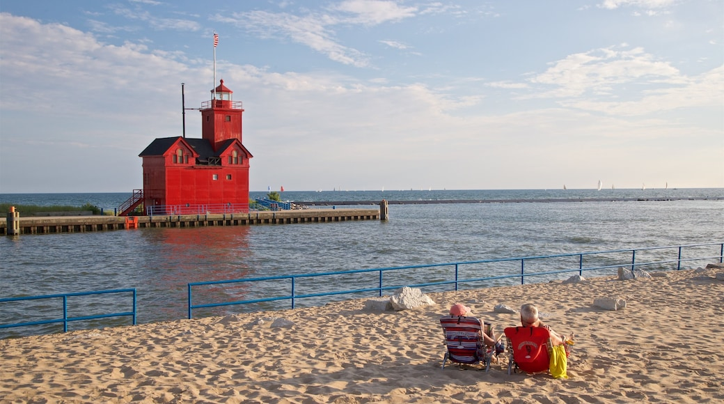Holland showing a lighthouse, general coastal views and a sandy beach