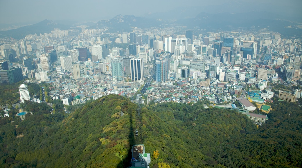 N Seoul Tower showing a high-rise building, city views and a city