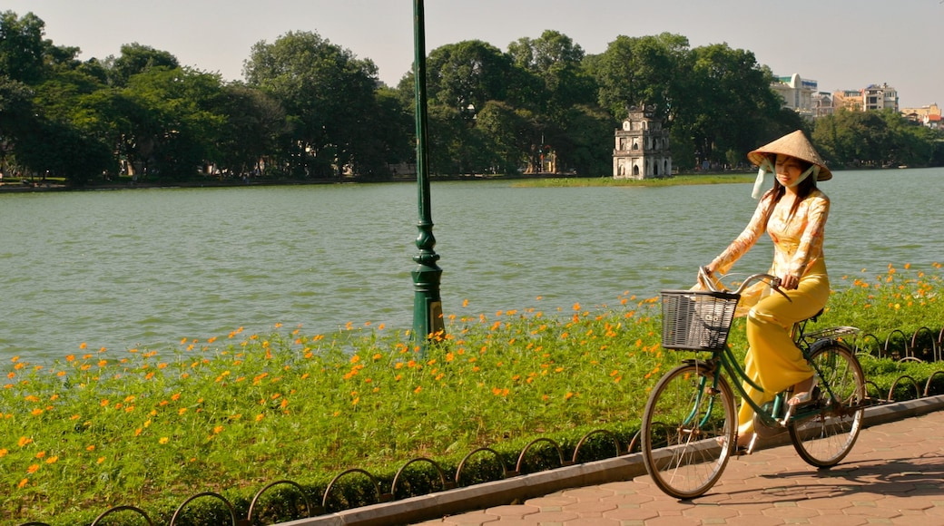 Hanoi showing cycling as well as an individual female