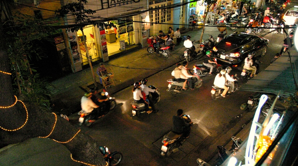 Hanoi which includes night scenes, a city and street scenes