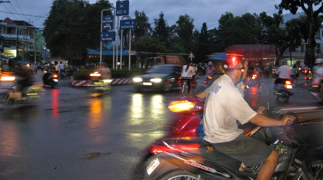Nha Trang featuring night scenes, motorcycle riding and street scenes