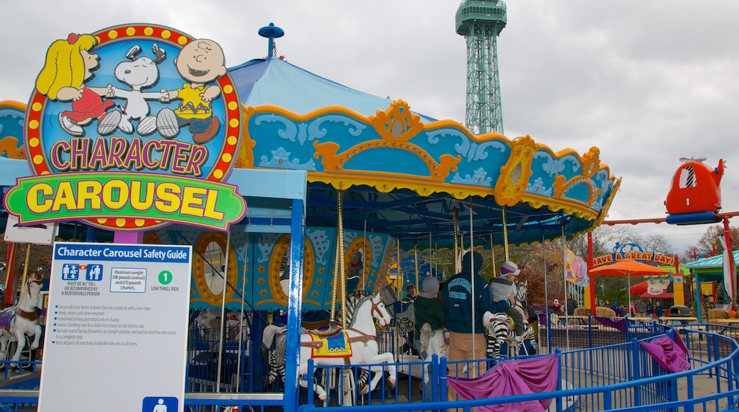 Kings Island featuring signage and rides