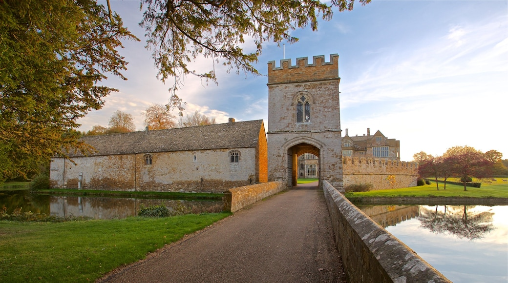 Broughton Castle featuring heritage architecture, a sunset and château or palace