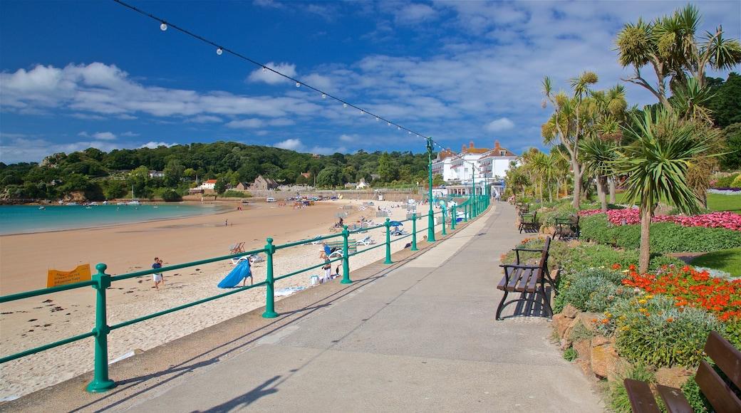 St Brelade\'s Bay Beach showing a beach, general coastal views and flowers