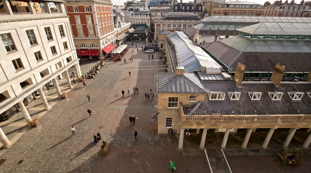 Royal Opera House som visar en stad och gatuliv såväl som en liten grupp av människor