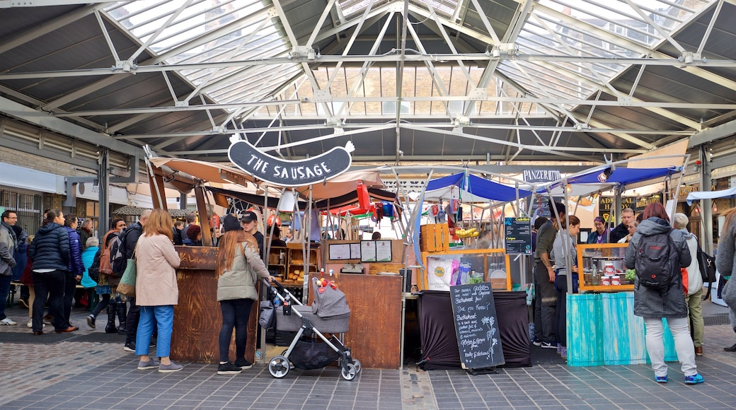 Greenwich Market featuring markets as well as a small group of people