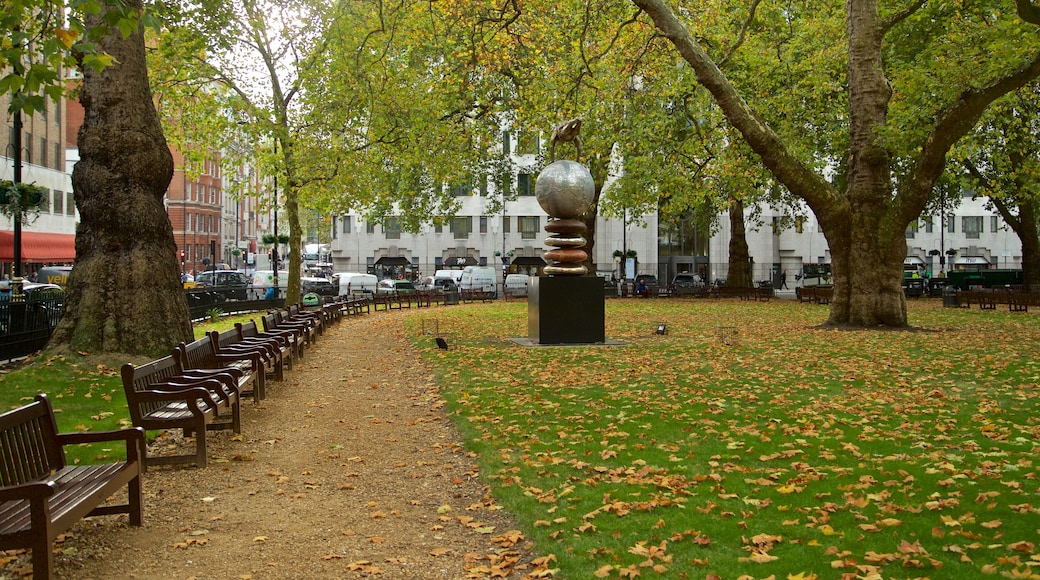 Berkeley Square showing a park, outdoor art and autumn leaves