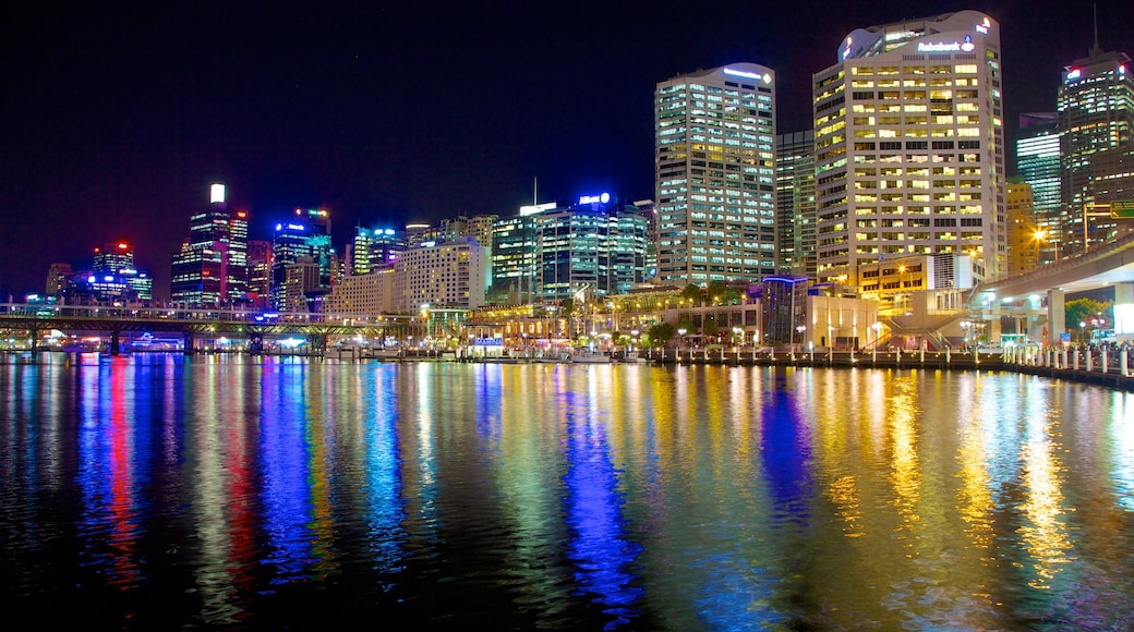 Darling Harbour which includes central business district, night scenes and a bay or harbor