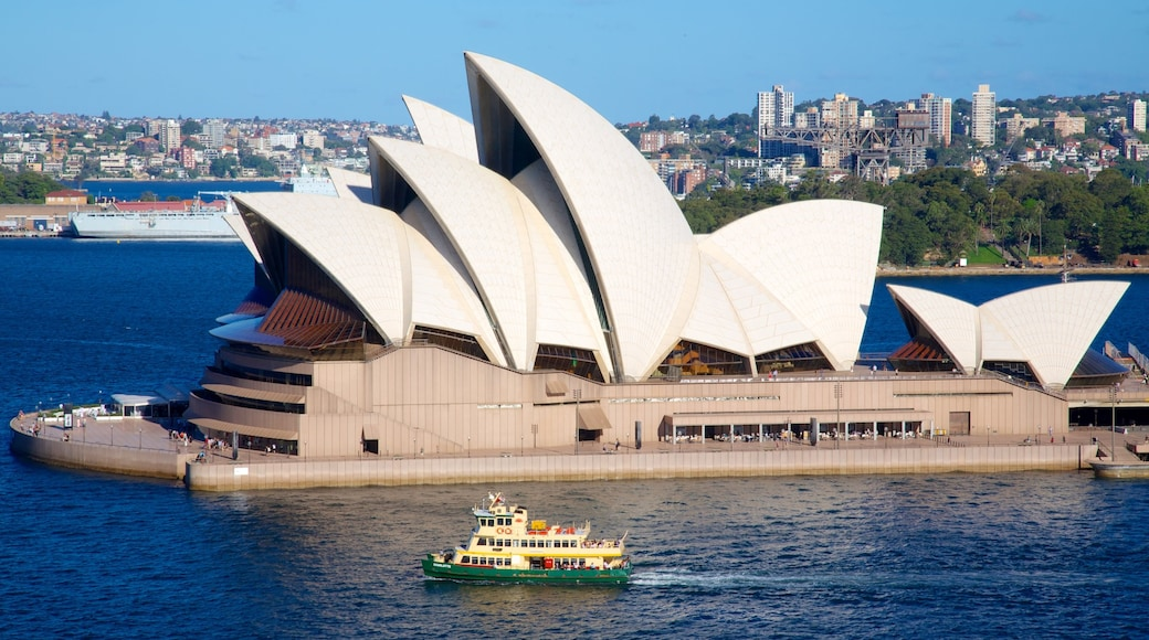 Sydney Opera House showing a bay or harbour, boating and a city