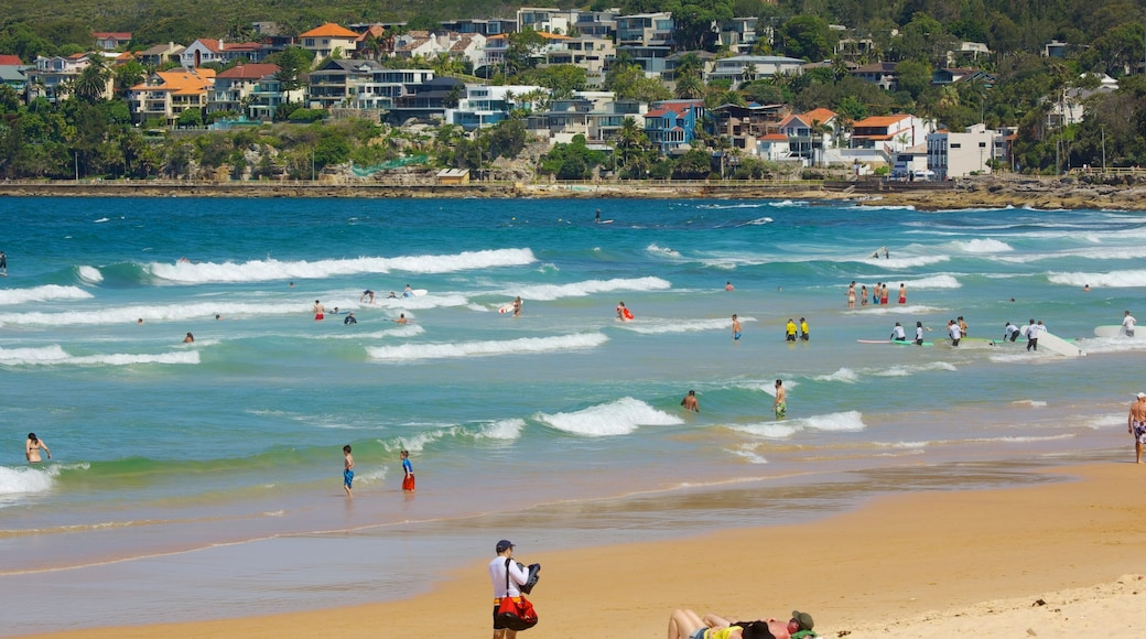 Manly Beach showing a beach, a coastal town and swimming