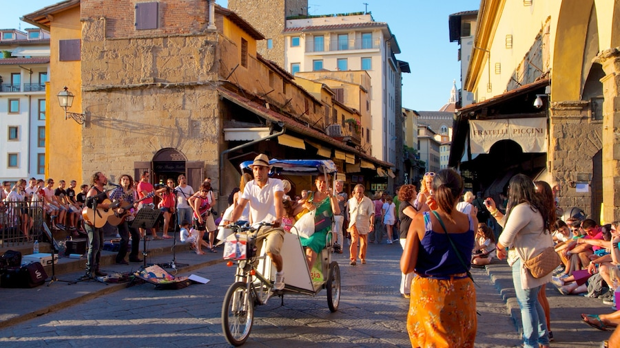 Ponte Vecchio which includes vehicle touring, street performance and a city
