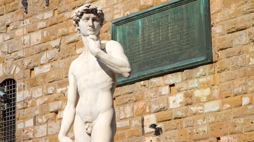 Piazza della Signoria featuring a statue or sculpture, outdoor art and a city