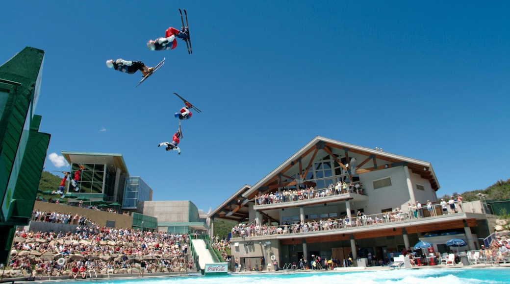 Park City featuring a sporting event and performance art as well as a large group of people
