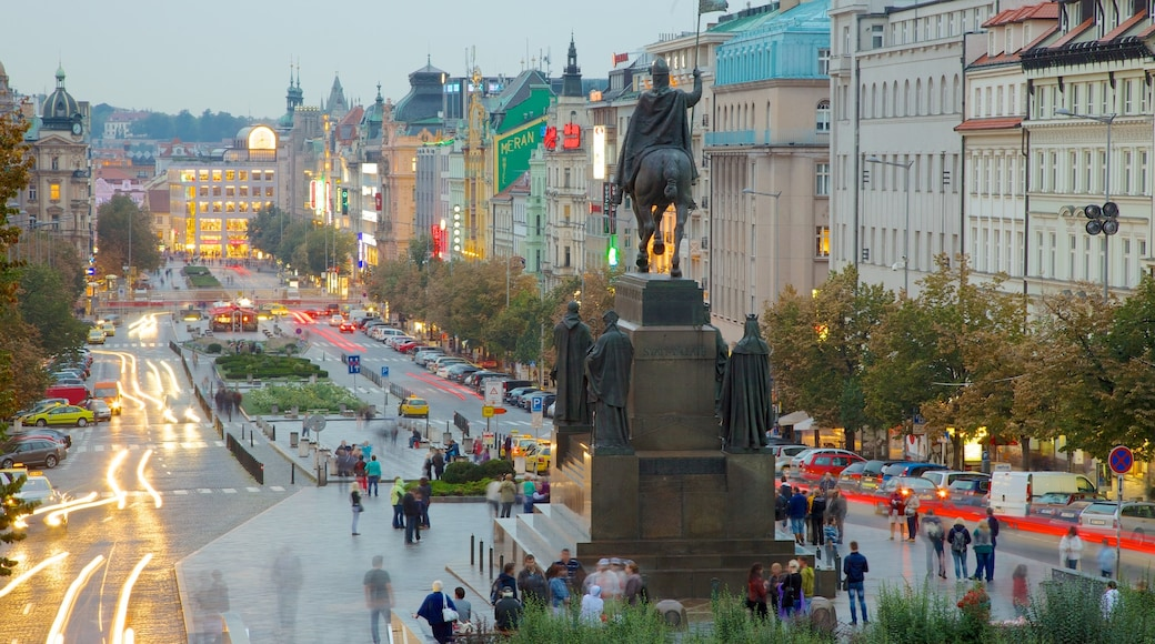 Wenceslas Square showing a church or cathedral, a statue or sculpture and city views