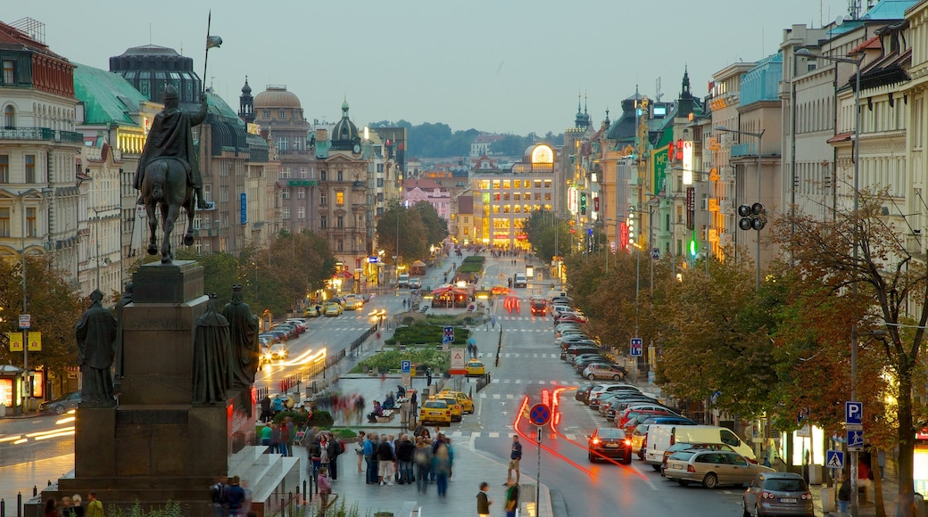 Wenceslas Square featuring a monument, a statue or sculpture and a city