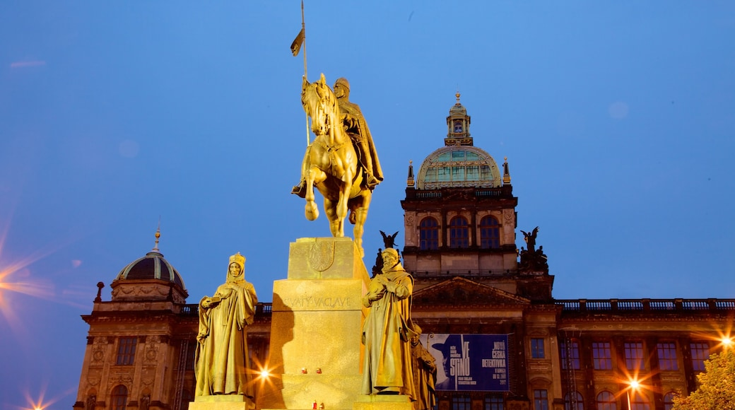 Wenceslas Square showing a statue or sculpture, night scenes and heritage architecture